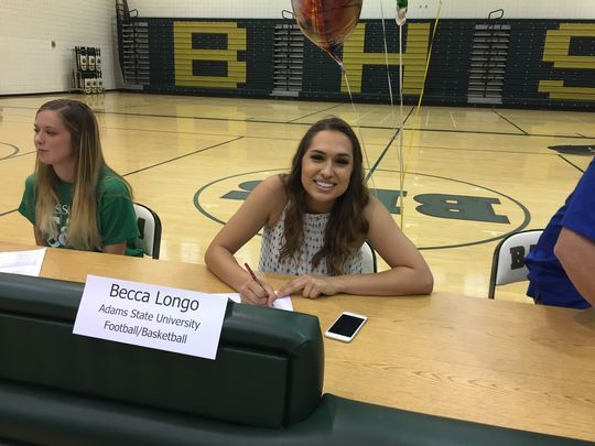 Chandler Basha kicker Becca Longo signs her letter of intent to play college football at Adams State. (Photo- Richard Obert:azcentral sports)