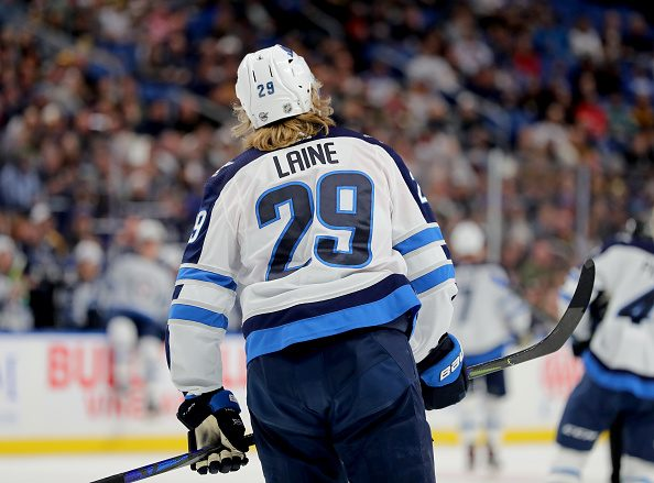 Assessing the Recent NHL Blockbuster Trade: Dubois, Laine, and Roslovic